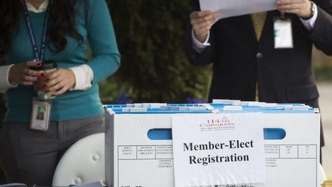 Congressional staff members prepare materials for newly elected lawmakers' orientation in this 2014 photo.