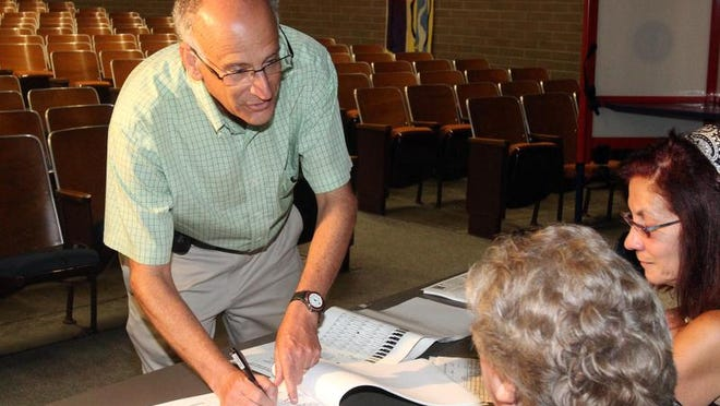 Greenburgh Supervisor Paul Feiner signs in to vote Sept. 10 at Ardsley Middle School in Ardsley.