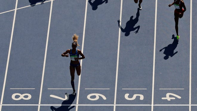 United States' Deajah Stevens wins her heat in the 200 meter during the athletics competitions of the 2016 Summer Olympics at the Olympic stadium in Rio de Janeiro, Brazil, Monday, Aug. 15, 2016.