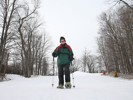 Democrat and Chronicle reporter Patti Singer snowshoes