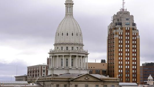 The state Capitol building and Boji Tower and other buildings in downtown Lansing in 2014.