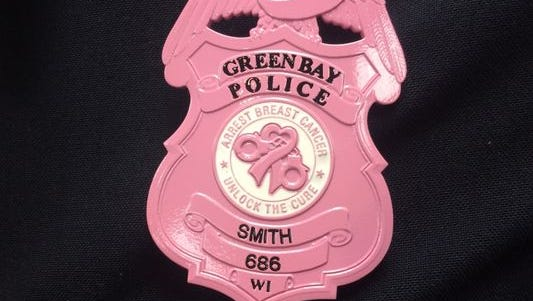 Green Bay police will wear pink badges in October to draw attention to Breast Cancer Awareness Month.