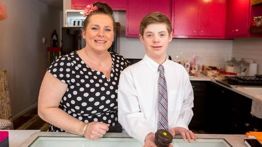 Patricia Puskas Truel, owner of Cupcakes on 8th, located at 509 East 8th Street, in Marshfield, Wis., serves cupcakes and customs cakes while John, 12, is learning how to use the cash register and handle transactions. Taken on March 27, 2017.
