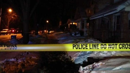 Grand Rapids Police put up crime tape as they investigated a death on the southwest side of Grand Rapid early Wednesday, Jan. 10.