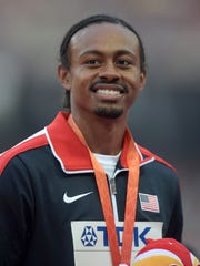 Aries Merritt (USA) poses after placing third in the