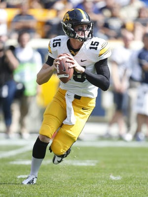 Iowa Hawkeyes quarterback Jake Rudock (15) rolls out of the pocket with the ball against the Pittsburgh Panthers during the first quarter at Heinz Field. The Hawkeyes won 24-20.