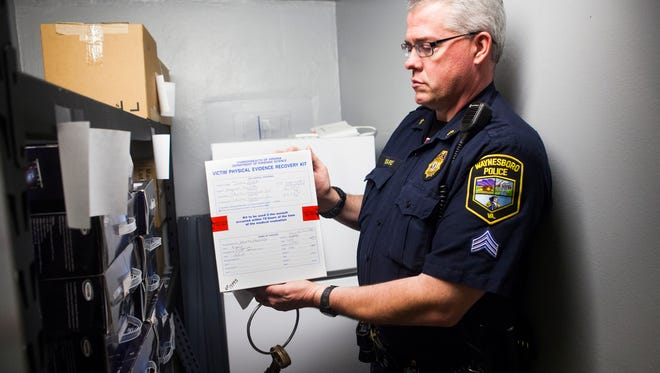 Waynesboro, Va., Police Sgt. Brian Edwards holds up a rape kit first processed in 2011 that is preserved for possible testing in the department's evidence room annex on July 8, 2015.