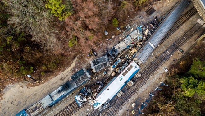 This Feb. 4, 2018, file photo shows an aerial view of the site of a fatal train crash between an Amtrak train, bottom right, and a CSX freight train, top left, in Cayce, S.C.