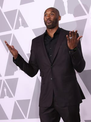 Kobe Bryant arrives at the 90th Oscars nominees luncheon at the Beverly Hilton.