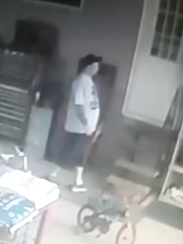 Suspect is seen on surveillance video at the home in