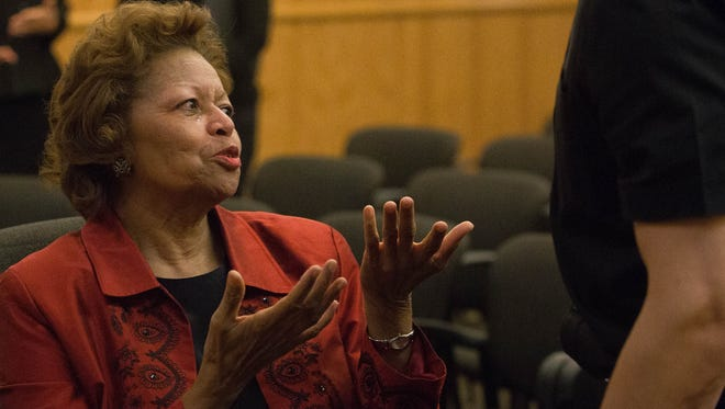 Julia Brown, former county manager, with tears in her eyes spoke to Eric Bransford after her contract terminated during the County Commission meeting Tuesday, April 25, 2017.