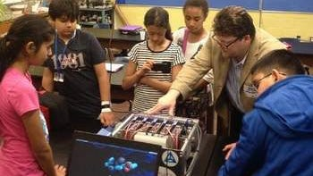 "Dr. Joiner and students view components of ""LittleFe"" super-computer."