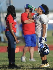 Cooper receiver Daelin Campos, right, hydrates during practice Monday, Oct. 9, 2017 at Cooper High School.