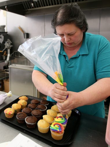 Lois Sietman frosts cupcakes at her Nostalgia House