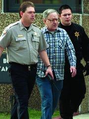 Defrocked priest Gilbert Gauthe leaves jail in 2000.