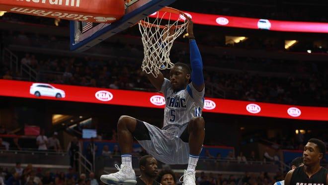 Apr 8, 2016; Orlando, FL, USA; Orlando Magic guard Victor Oladipo (5) dunks during the second half at Amway Center. Orlando Magic defeated the Miami Heat 112-109.
