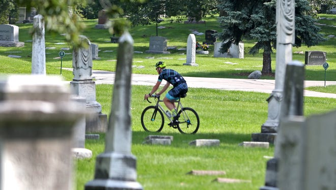 Crown Hill Cemetery is popular with bicyclists, but new rules are being instituted.