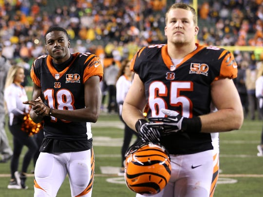 Cincinnati Bengals wide receiver A.J. Green (18), left, and Cincinnati Bengals offensive guard Clint Boling (65), walks off the field after the 23-20 loss to the Pittsburgh Steelers in the Week 13 NFL game, Tuesday, Dec. 5, 2017, at Paul Brown Stadium in Cincinnati. Pittsburgh won 23-20.