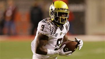 Oregon running back Byron Marshall (9) carries the ball in the first quarter during an NCAA college football game against Utah Saturday, Nov. 8, 2014, in Salt Lake City. (AP Photo/Rick Bowmer)