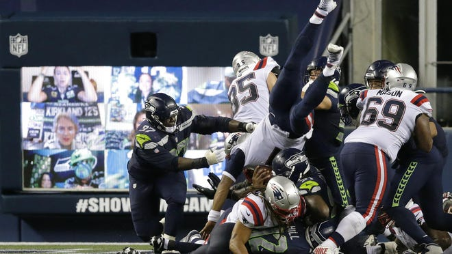 Patriots quarterback Cam Newton dives for the end zone but is stopped short of the goal line as the clock expires in the fourth quarter of Sunday night's game against the Seahawks. Seattle won, 35-30.