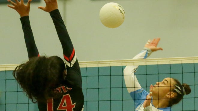 Ponte Vedra middle hitter Zeta Washington, right, hits around Port Charlotte middle hitter Azyah Dailey (14) during the Class 5A state semifinal. Washington is among the locals named to the AVCA Phenom List.