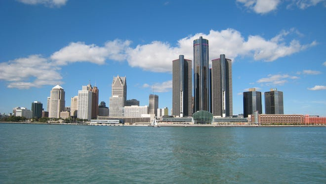 The skyline of the City of Detroit as seen from the Detroit River with the Renaissance Center being the tallest buildings in October 2013.