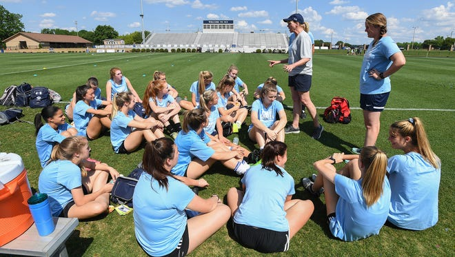 Southside Christian School girls soccer coach Sheila Wyer talks with her team before practice Tuesday, May 8, 2018. The Sabres will play Academic Magnet Friday in Columbia for the Class AA state championship.