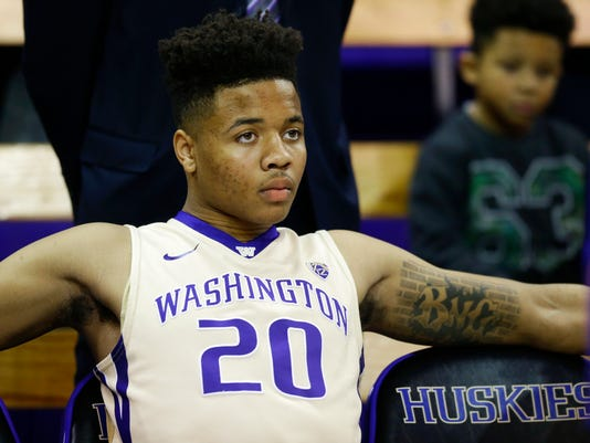 Washington guard Markelle Fultz sits on the bench before being introduced for the team's NCAA college basketball game against Arizona State, Thursday, Feb. 16, 2017, in Seattle. (AP Photo/Ted S. Warren)