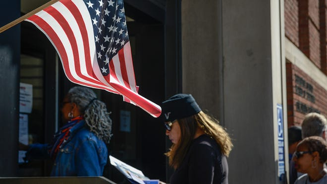 Cincinnati voters walk into the Hamilton County Board of Elections for early voting in October 2014. At least 26 Hamilton County voters cast two ballots in the November election, but no extra votes were counted.