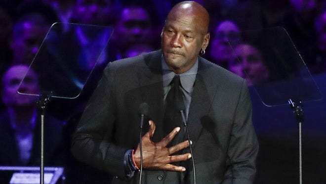 "Michael Jordan, shown while speaking during a celebration of life for Kobe Bryant earlier this year, said he is ""deeply saddened, truly pained and plain angry,"" over the death of George Floyd."