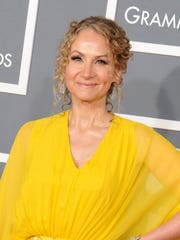 "Singer Joan Osborne arrives at the 55th annual Grammy Awards, in Los Angeles. The Grammy-nominated singer of the hit ""One of Us"" has put together an album of her unique takes on 13 of his classic songs."