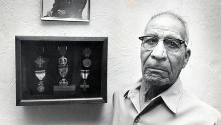 Marcelino Serna stands before his World War I medals in 1978. Serna moved to El Paso at the end of the war. He died in 1992 at the age of 95.