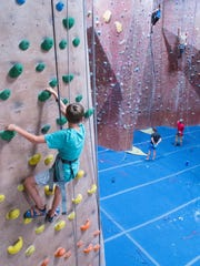 Kyle Johnson tries out top-rope climbing for the first time at AZ on the Rocks in north Scottsdale. The gym also features lead climbing and bouldering as well as yoga and Ninja-Warrior style fitness classes.