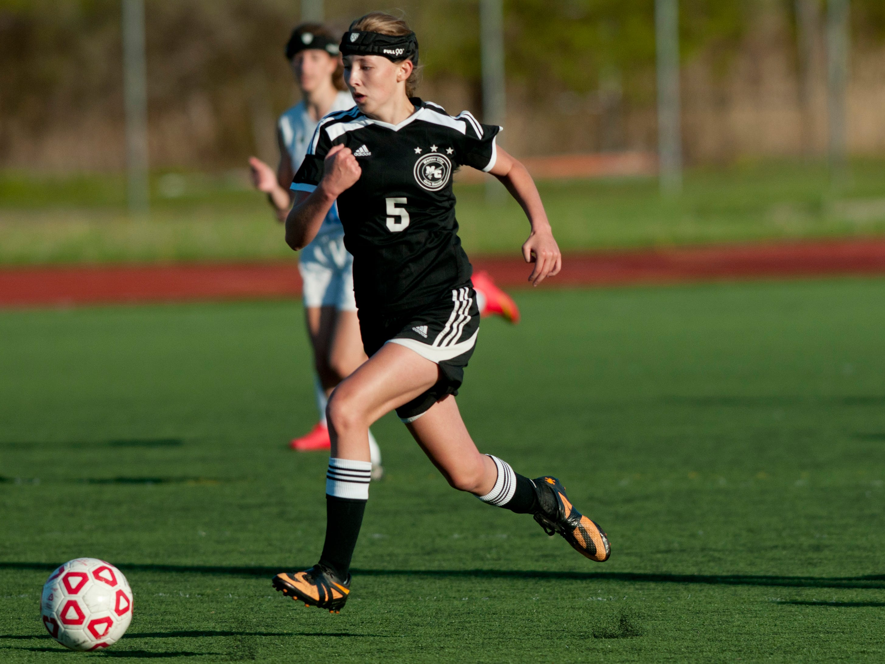 Marine City sophomore Emilie Andrews goes for a shot on goal during a soccer same Wednesday, May 13, 2015 at East China Stadium.