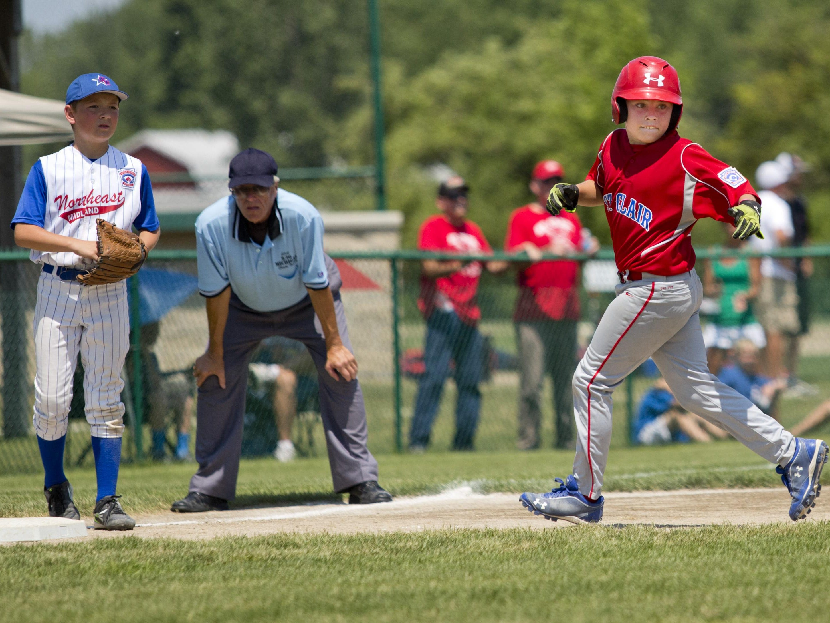Caleb Achatz gets to third during a 10-and-under state semifinal baseball game Tuesday, July 28, 2015 in St. Clair.
