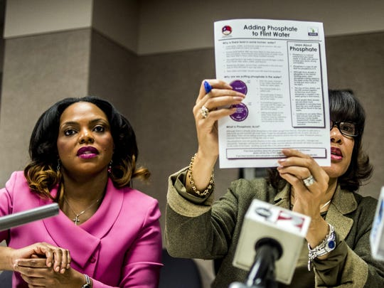 Flint Mayor Karen Weaver, right, and City Administrator Natasha Henderson address questions about adding supplemental phosphates to the city's water during a news conference, Thursday, Dec. 10, 2015 at City Hall in Flint, Mich. The city says phosphates are being added to drinking water in an effort to help deal with problems with lead caused by the city's earlier use of Flint River water. (Jake May/The Flint Journal-MLive.com via AP) LOCAL TELEVISION OUT; LOCAL INTERNET OUT; MANDATORY CREDIT