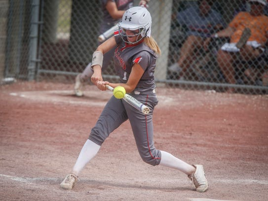 Ballard senior Abby Carlin connects on a pitch against