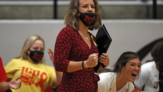 Lubbock-Cooper coach Karli Morrison cheers for her team during a nondistrict match Sept. 29 against Canyon Randall in Woodrow, Texas.