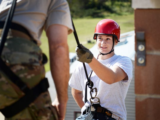 Troy Keenan, a JROTC students from Enka High, looks to First Sergeant Chad Prevatte as he prepares to rappel down a training tower at the Swannanoa Fire Department October 18, 2017.