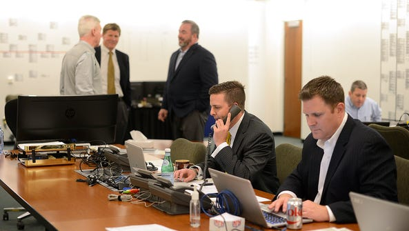 In middle, Green Bay Packers director of player personnel