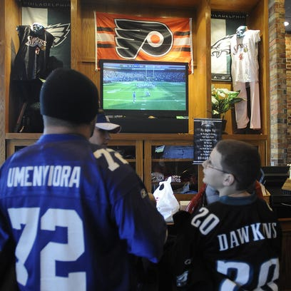 Fans watch a Flyers game at Champps. The Marlton restaurant