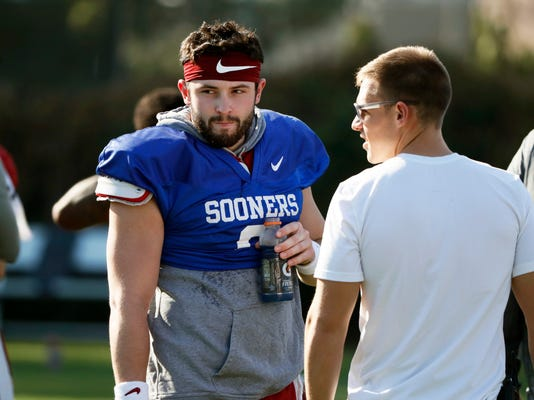 Oklahoma quarterback Baker Mayfield takes a breather after he participated in drills during a short segment of Rose Bowl practice that was open to the media, Friday, Dec. 29, 2017, in Carson, Calif. Oklahoma plays Georgia in a semifinal of the College Football Playoff on New Year's Day. (Bob Andres/Atlanta Journal-Constitution via AP)