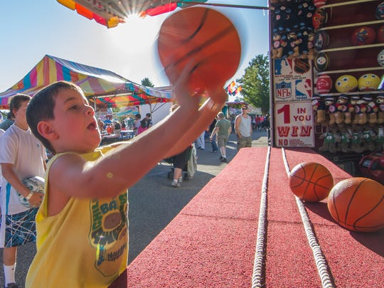 Parker Lemery, 7, of Shelburne tries his luck at a basketball game at the Champlain Valley Fair on Aug. 24.