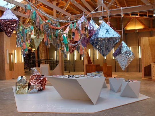 An installation features CONFETTISYSTEM Quartz and Crystal Pinatas and Twist Rope Garlands in Los Angeles. CONFETTISYSTEM transforms simple materials such as tissue paper, cardboard, and silk into interactive objects that are filled with handcut confetti. There's a hinged door for you to add additional treats/favors to a pinata too.