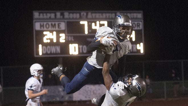 Timber Creek's Blaine Shade is hoisted in the air by teammate J.P. Roane after scoring on a 19-yard pass in the fourth quarter of Friday's South Jersey Group 4 semifinal against Shawnee.