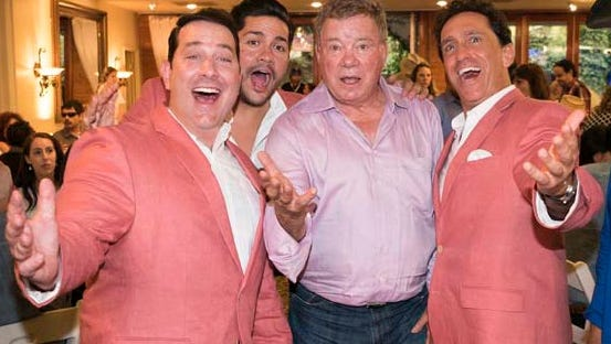 The Sicilian Tenors with a fan.