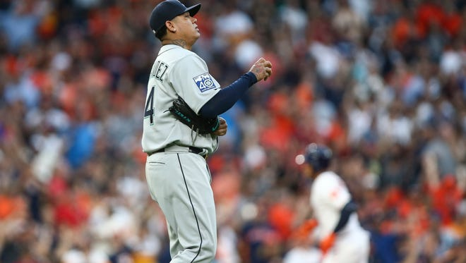 Seattle Mariners pitcher Felix Hernandez reacts as Houston Astros center fielder George Springer rounds the bases after hitting a home run during the first inning at Minute Maid Park.