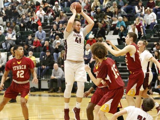Dan Fedor of Elmira grabs a rebound against Ithaca on Tuesday night at Elmira High School.