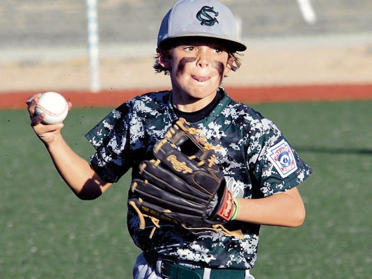 Matt Hollinshead — Current-Argus Shorthorn Green shortstop Nye Estrada throws to first base for a quick put out in the top of the second inning Monday. Shorthorn Green defeated American Red 11-1 for the 10-year-old District All Star tournament title.