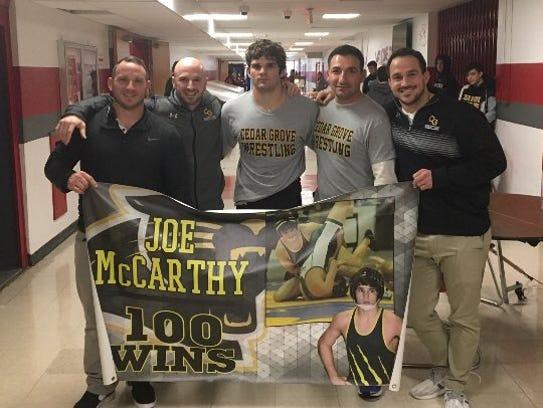 Senior Joe McCarthy (center) earned his 100th career